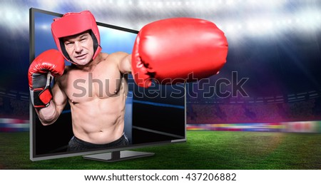 Boxer punching against black background against composite image of boxing ring - stock photo