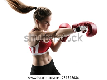 Boxer woman during boxing exercise making direct hit with red glove / photo set of sporty muscular female brunette girl wearing sports clothes over white background - stock photo