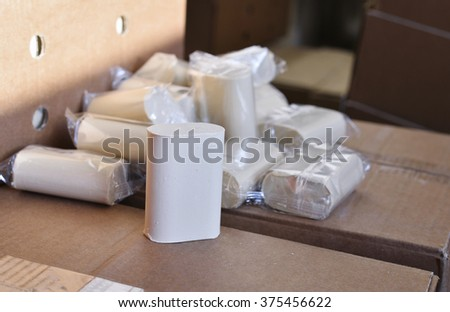 Boxes and bars of soap factory - stock photo