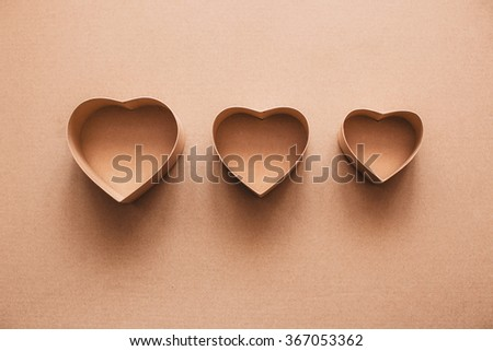 Boxes heart different sizes on kraft paper. The symbol of Valentine's Day love. - stock photo