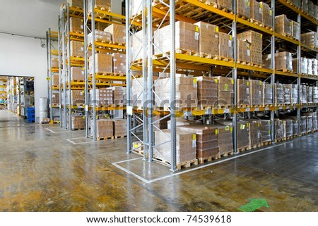 Boxes in modern logistic distribution storehouse interior - stock photo