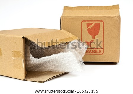 Boxes made ??of corrugated cardboard made ??of recycled paper intended for the packaging of various articles - stock photo