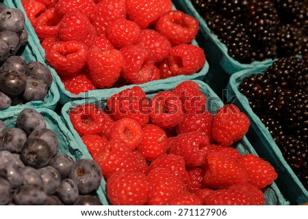 Boxes of Berries in a farmers market - stock photo