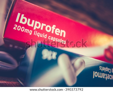 Boxes Of Prescription Painkillers Ibuprofen And Paracetamol On A Shelf At Home