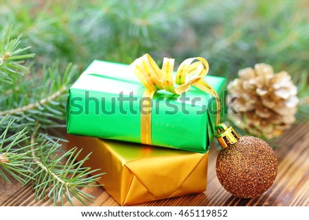 Boxes of presents in christmas decoration on wooden background