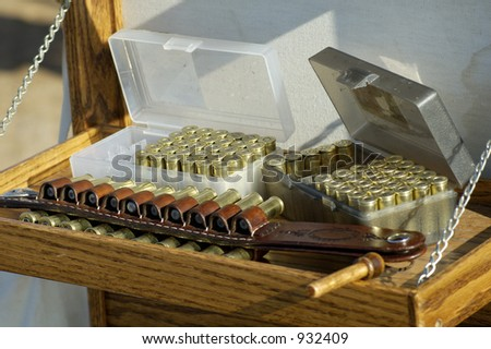 Boxes of shells at a cowboy shooting competition. - stock photo