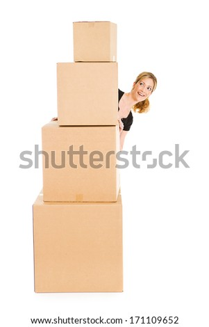 Boxes: Peeking Around Stack of Cardboard Boxes