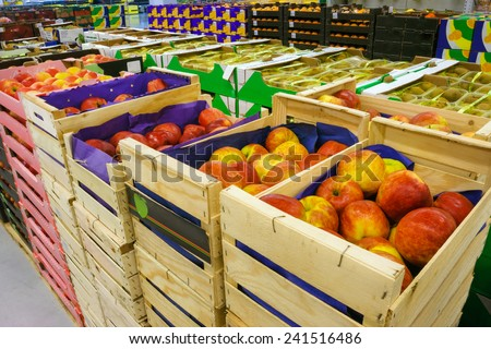 Boxes with apples in the food store  - stock photo