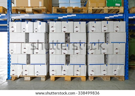 Boxes with Goods at Pallets in Distribution Warehouse - stock photo