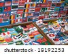 Boxes with patches of flags on a market in asia - stock photo