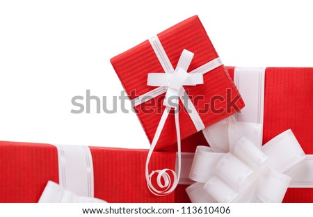 Boxes with presents wrapped in red paper, isolated on white - stock photo