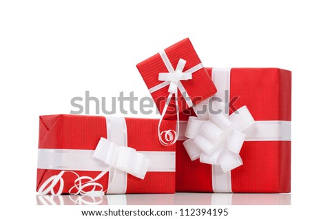Boxes with xmas presents wrapped in red paper, isolated on white