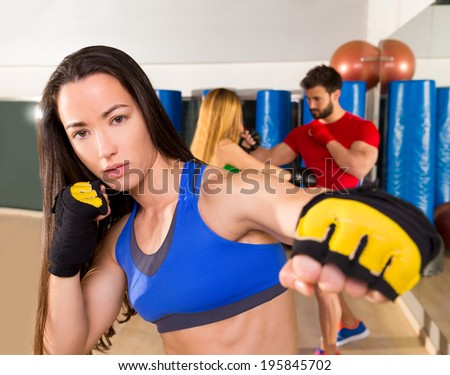 Boxing aerobox brunette woman portrait in fitness gym training workout - stock photo