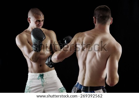 Boxing fighting in the ring-film grain is added - stock photo