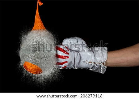 boxing glove bursting balloon filled with water - stock photo