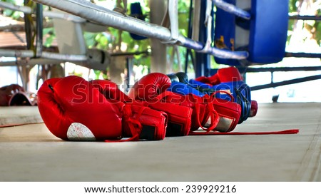 boxing glove on a outdoor boxing ring - stock photo