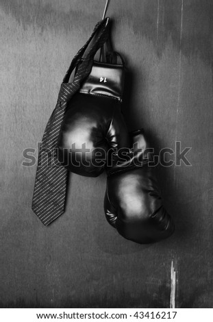 Boxing-glove with a necktie - stock photo