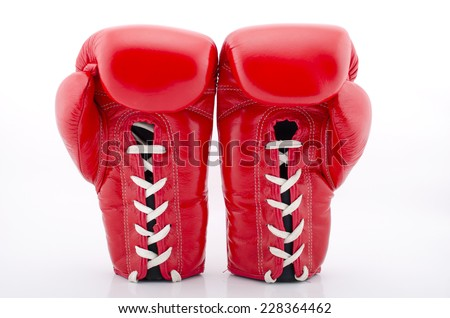 Boxing gloves against a white background - stock photo