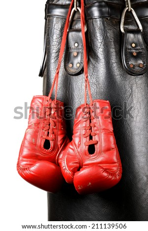 Boxing gloves and punching bag isolated on white background