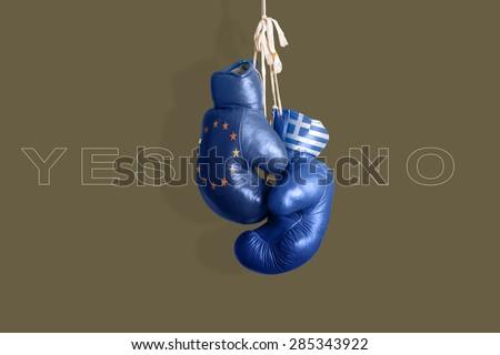 Boxing gloves as a symbol of Greece vs. the EU - stock photo