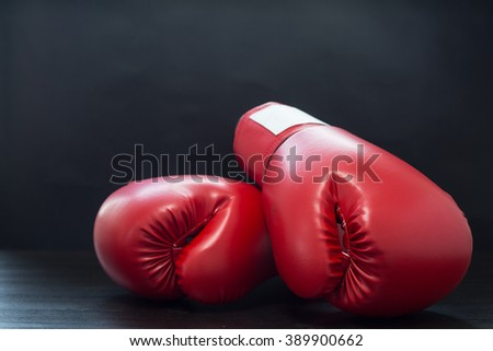 Boxing gloves for boxer with black blackground - stock photo