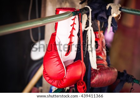 Boxing gloves hanging from Boxing Field - stock photo