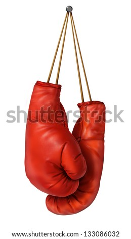 Boxing gloves hanging on a isolated white background with laces nailed to a wall as a business or sport concept of a person that retires gives up the fight or prepares for competition. - stock photo