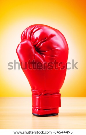 Boxing gloves on the table - stock photo