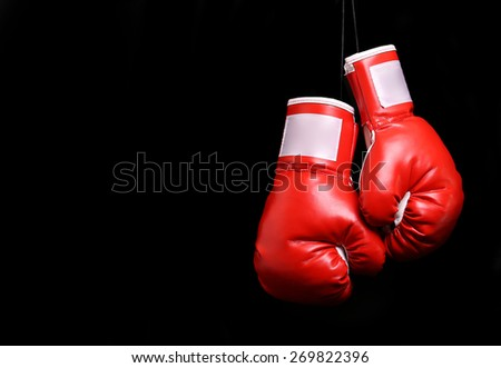 Boxing gloves over black background - stock photo