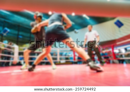 Boxing match abstract blur sports background with bokeh - stock photo