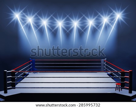 Boxing ring and floodlights , Boxing event , Sport Arena - stock photo