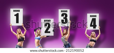 Boxing ring girls holding a board with round number isolated on violet background. set.  High resolution  - stock photo