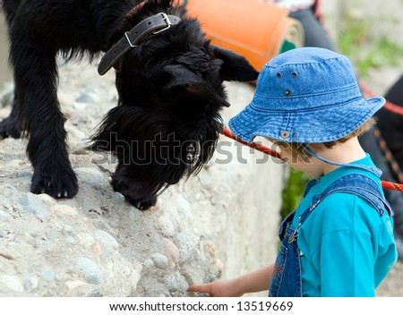 Boy and big dog (series Children and Animals) - stock photo