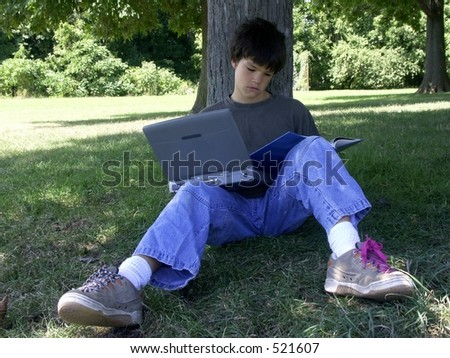 boy and computer reading #2 - stock photo