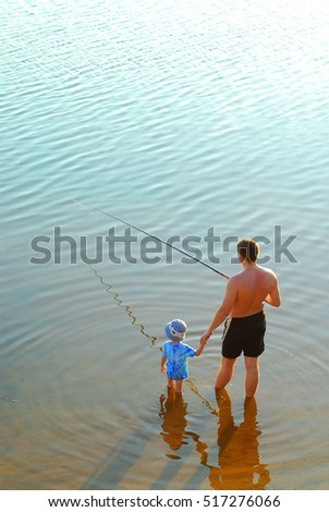 Boy and dad on a fishing trip.