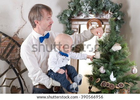 boy and dad under the Christmas tree - stock photo