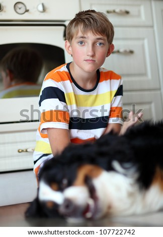 Boy and dog. Focus on  boy