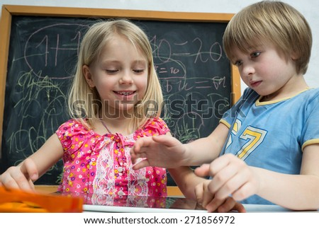 Boy and girl are playing with clipboard computer - stock photo