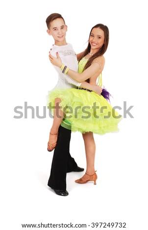 Boy and girl dancing ballroom dance on white background - stock photo