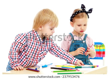 boy and girl draws felt-tip pensChildhood education development in the Montessori school concept. Isolated on white background. - stock photo