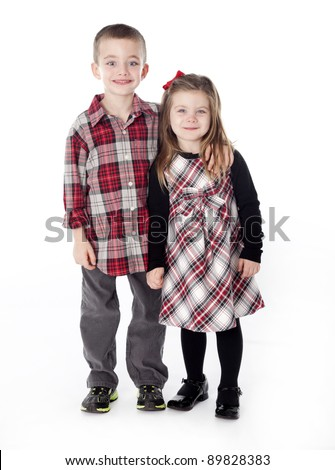 Boy and Girl embracing in studio isolated on white - stock photo