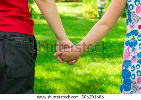 Boy and girl friends are taking each other's hand
