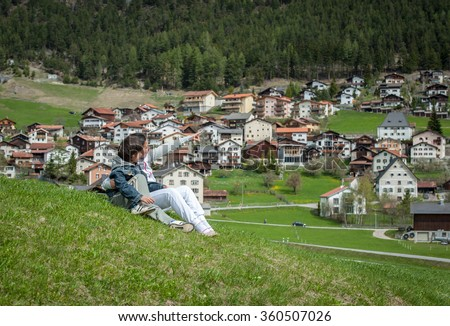 Boy and girl having beautiful spring vacation in idyllic Alps - stock photo