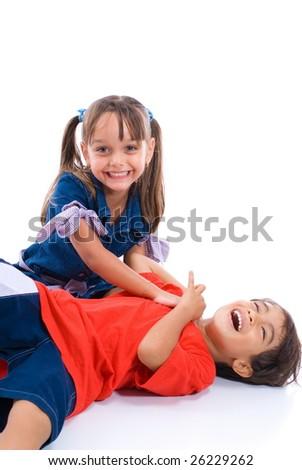 Boy and Girl having fun on white background . - stock photo