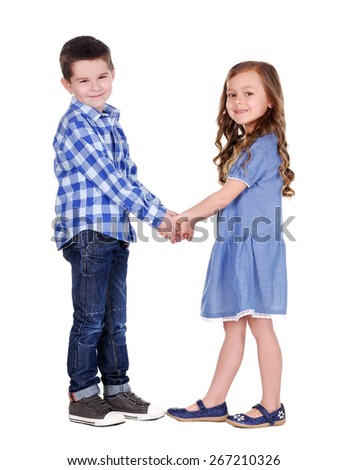 boy and girl  holding hands in hands full length portrait - stock photo