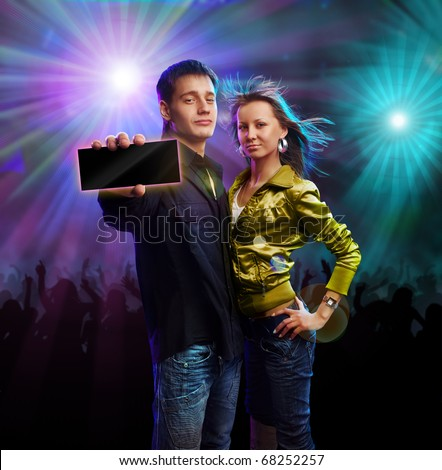 Boy and girl in a club showing card - stock photo