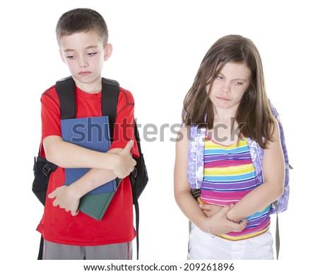Boy and girl in backbacks with books feeling depressed - stock photo