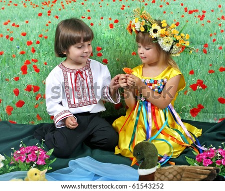 boy and girl in traditional costume against the backdrop of the field