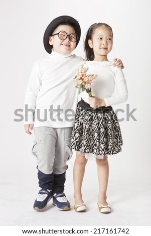 boy and girl love together with flower. - stock photo