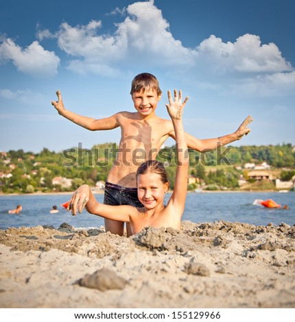 Boy and Girl on the public beach Strand at Danube river in Novi Sad, Serbia.